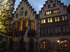 The Frankfurt town hall is the building with the clock and flags. See the giant decorated Christmas tree!